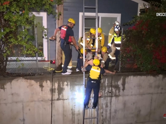 Firefighters rescue man in Fullerton flood-control channel during downpour