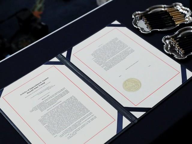 Photos show the articles of impeachment against Trump