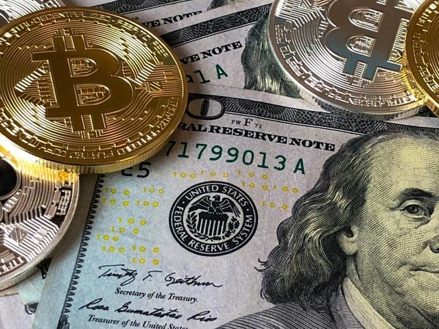 Will bitcoin save the world from 'highly aggressive weaponized US-dollar Empire'? Keiser Report explores