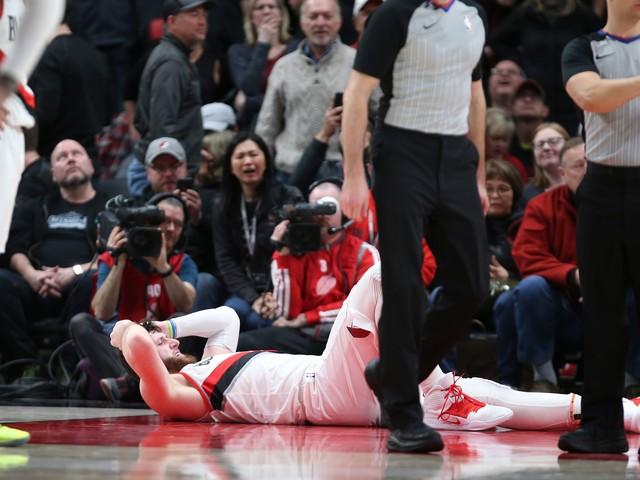 Blazers lose Nurkic to severe leg injury, edge Nets in 2 OTs