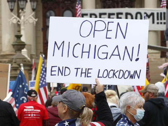 A Michigan Barbershop Used Armed Militia To Stop Police From Shutting Them Down