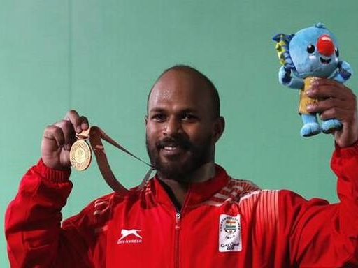 Third gold for India at CWG, British war games in Kenya, and other news in pictures