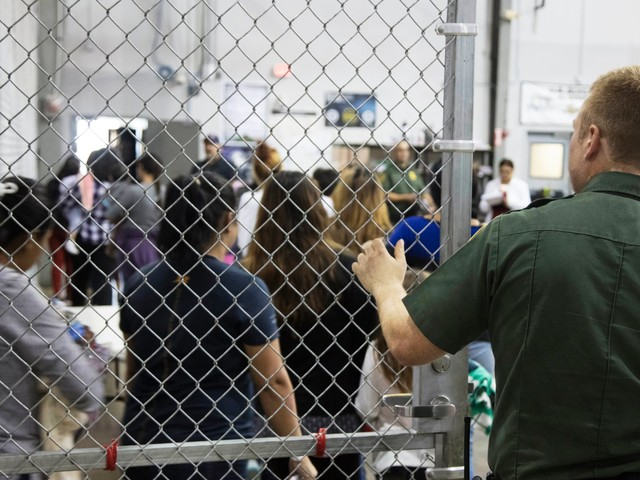 Video shows migrant men detained in an overcrowded Texas facility yelling 'no shower' as Pence praised agents