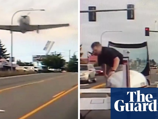 Plane's emergency landing on busy US highway captured on police camera – video