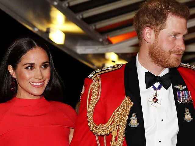 Harry & Meghan's Matching Red Outfits Ahead Of Their Royal Exit Have A Hidden Meaning