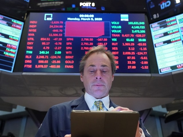 Dow slumps 800 points after Trump warns of 'painful' times to come and a 'shocking' coronavirus death toll
