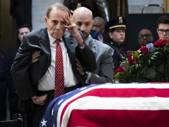 Bob Dole salutes former president Bush