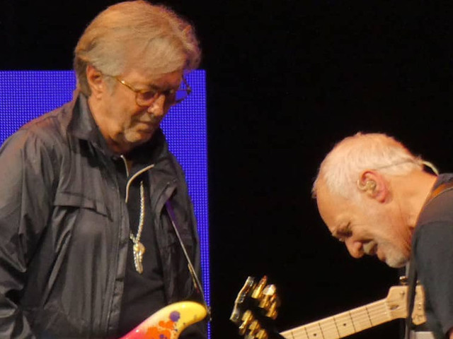 Eric Clapton Joins Peter Frampton On 'While My Guitar Gently Weeps' & Performs Acoustic Set At Crossroads