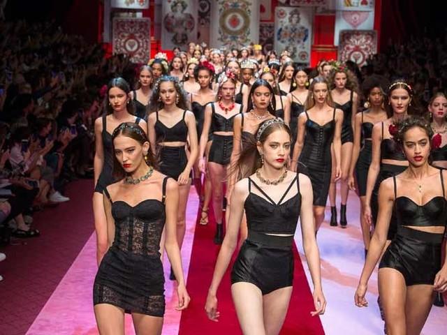 Milan fashion glitterati go behind the scenes