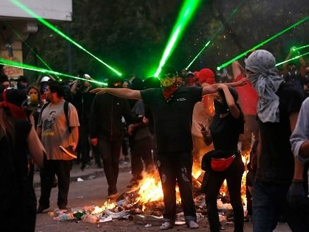 Watch Chile Protesters Kill A Police Drone Using Hundreds Of Laser Pointers