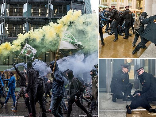 Police clash with anti-capitalist activists who target Bank of England and London Stock Exchange