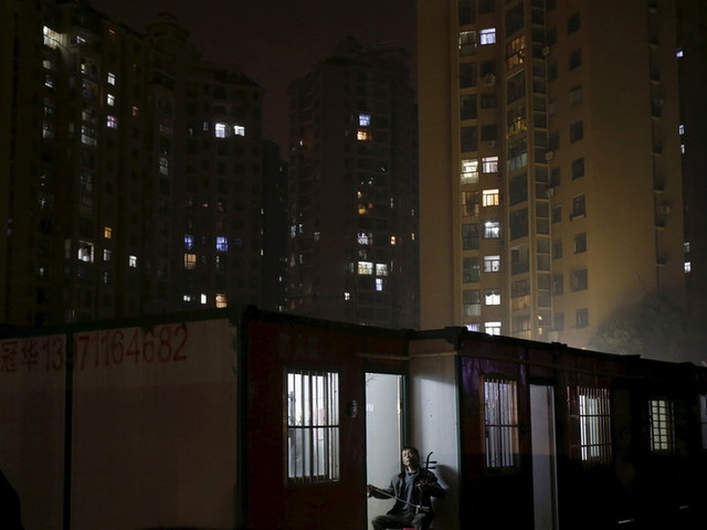 'Wuhan, you can do it!': Quarantined residents sing from their balconies in stirring VIDEOS
