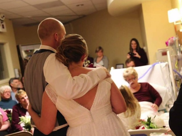 Couple expecting baby one year after getting married in mother of the bride's hospital room