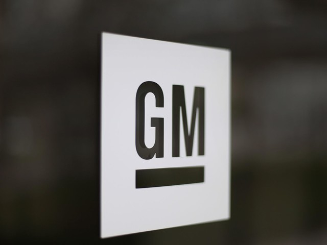 The Latest: UAW workers on job at GM plant as strike looms
