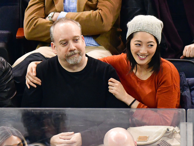 Paul Giamatti snuggles up to mystery woman at Rangers game