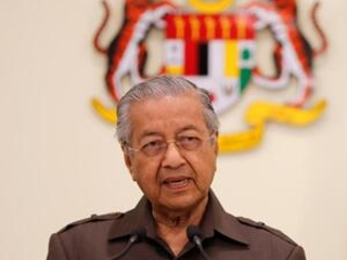 Mahathir says Chinese contractor will help run new rail link