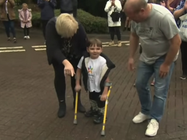 5-year-old who lost both of his legs from childhood abuse walked over 6 miles in June to raise over $1 million for the hospital that saved his life