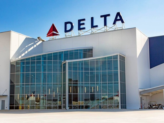 Having a Delta credit card gets you a free checked bag every time you fly the airline — here's how to use the perk