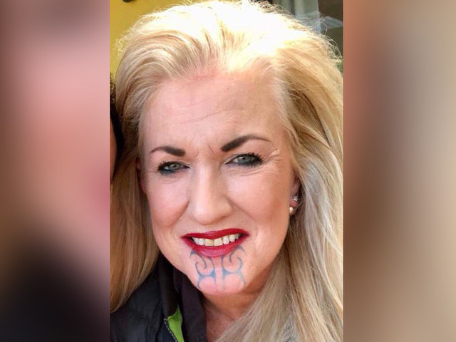 Life coach under fire over tribal face tattoo