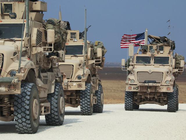 Residents of northeast Syria city pelt departing U.S. troops