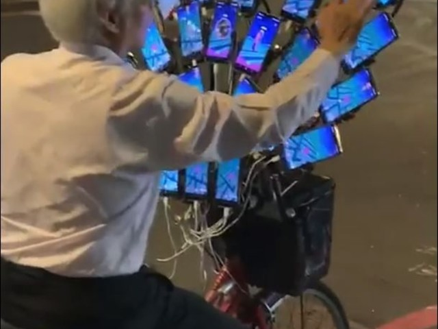 Hardcore Pokémon Go Grandpa Plays with 30 Phones at the Same Time