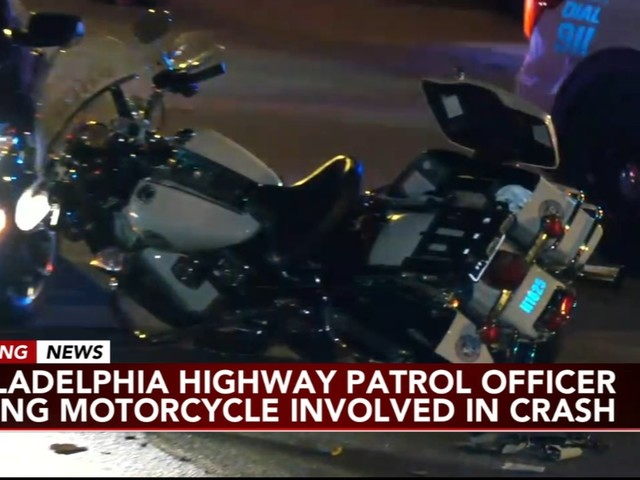 Philadelphia Highway Patrol Officer riding motorcycle hit by car