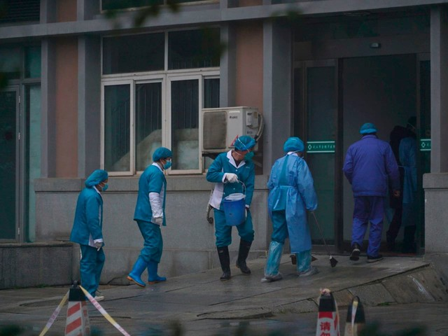 As families tell of pneumonia-like deaths in Wuhan, some wonder if China virus count is too low