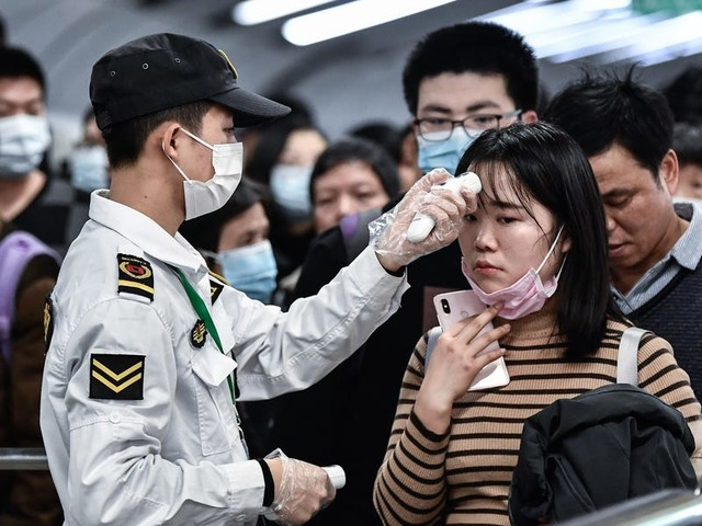 Photos show how China is grappling with the Wuhan coronavirus outbreak as 12 cities are quarantined and hospitals run out of space