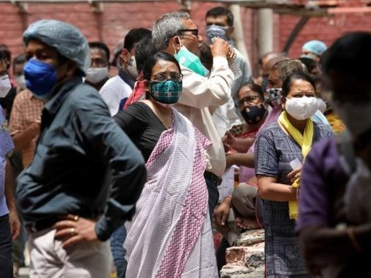 India Sees Cases Slow As Outbreak Spills Into Nepal; Regional Mutant Arrives In US