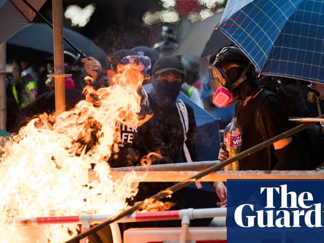 Hong Kong protests: police fire water cannon with blue dye as crowds defy ban
