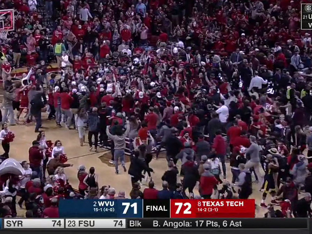 Texas Tech fans storm the court after knocking off No. 2 West Virginia
