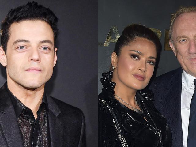 Rami Malek Attends Saint Laurent Fashion Show Alongside Salma Hayek & Husband Francois Henri Pinault