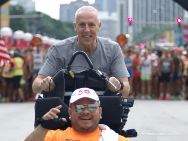 Runner helps those with disabilities complete marathons