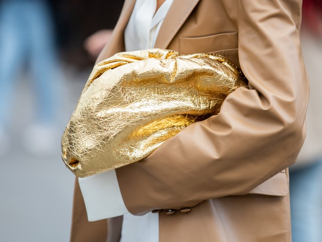 7 Sparkly Gold Nail Shades To Wear From Now Through NYE