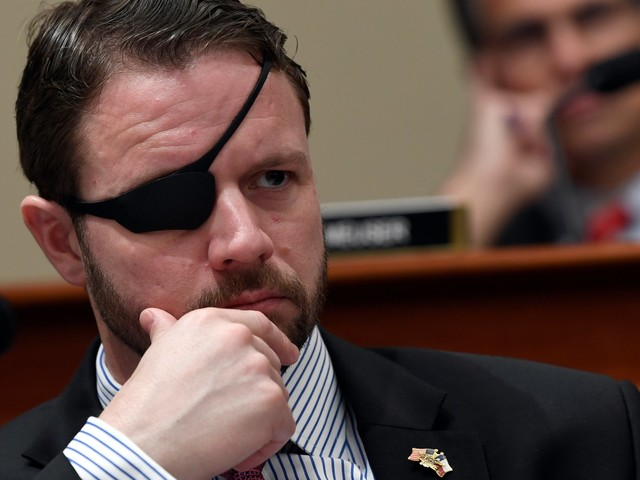 Rep. Dan Crenshaw claps back at critics who question his patriotism with an x-ray of his combat injury