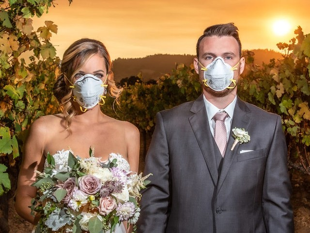 A couple wore protective face masks in their wedding photo during the California wildfires, and the striking image has gone viral