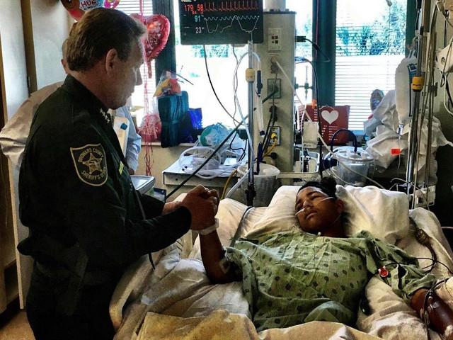 Sheriff visits boy shot while shielding classmates in school massacre