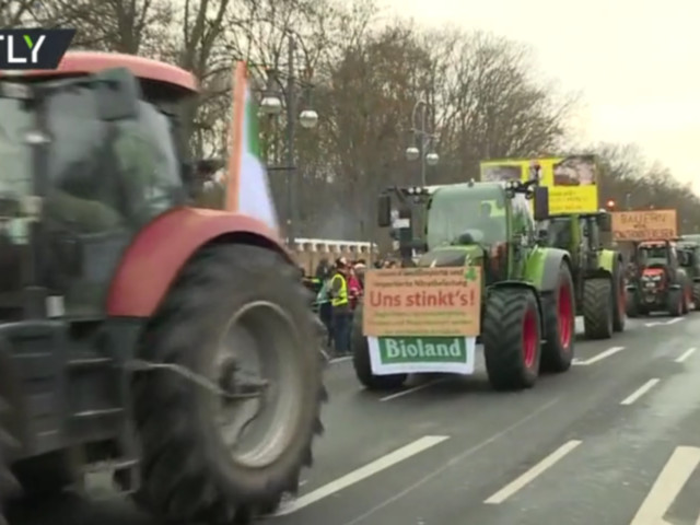 'We've had enough!' WATCH German farmers drive tractors through Berlin to protest agriculture policy