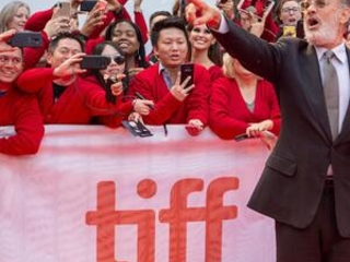 Would you be mine? Hanks unveils his Mr. Rogers at festival