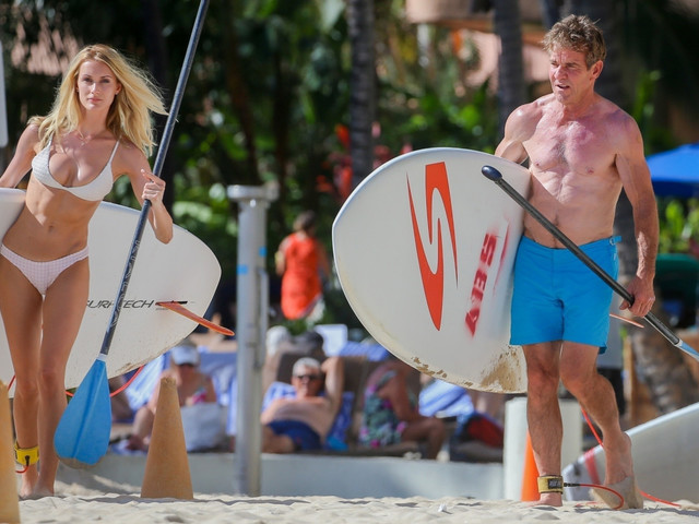 Dennis Quaid shows off jacked bod on beach with much younger girlfriend