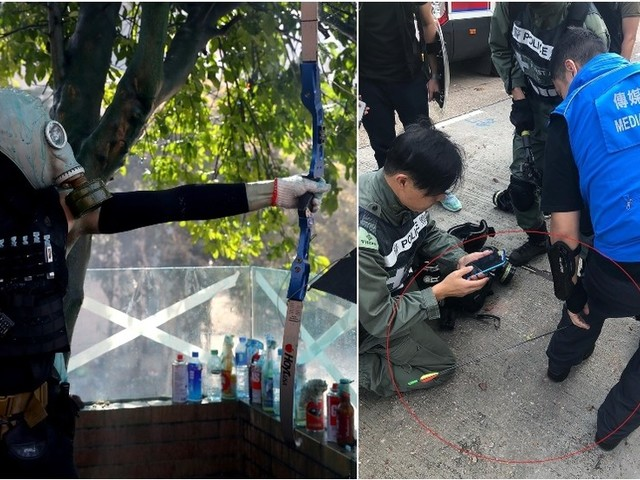 Hong Kong protesters hurl PETROL BOMBS at volunteers trying to clear roadblocks and shoot ARROWS at police