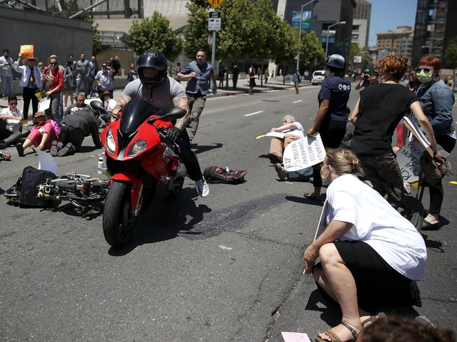 VIDEO: Biker Revs Engine, Drives Through Anti-Trump Activists Laying in the Street for a 'Die-In'