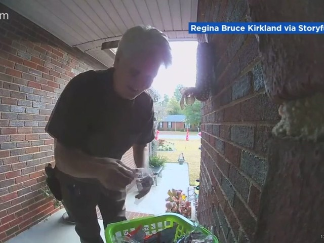 Georgia delivery driver's delighted reaction to front porch gifts caught on camera