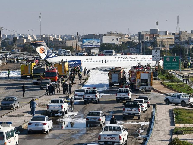 Jet with 135 aboard skids onto highway