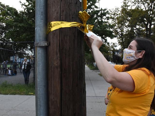 Bay Ridge locals hang golden ribbons to raise awareness of pediatric cancer