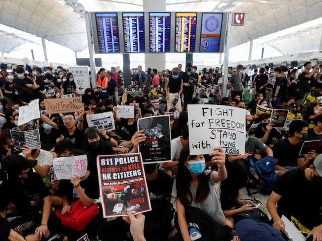 Hong Kong cancels all flights in and out of the city as protesters fill the airport for 4th day