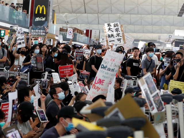 'Sorry for the inconvenience': Hong Kong protesters apologized to furious passengers after the city's airport was paralyzed for a second day