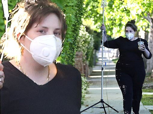 Lena Dunham is carries her IV drip stand on her 34th birthday