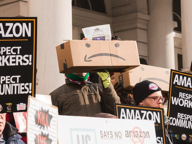 Amazon employees say they're scared to go to work, but they're not alone — here are 8 big companies facing worker criticism over their coronavirus safety response (AMZN, UBER, GOOG, GOOGL, MCD, TSLA)