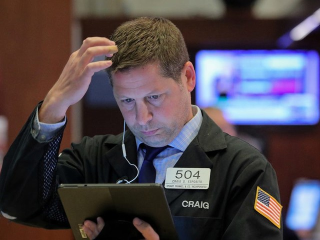 A Wall Street investment chief says stock market levels are 'completely unjustified' — and shares how he's positioning his portfolio in an economy that looks 'primed for recession'